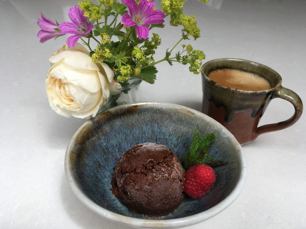 Ice cream in a bowl with a coffee.