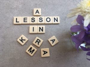 A lesson in Karma in scrabble letters.