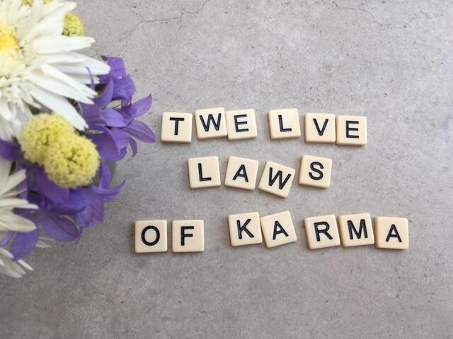 Twelve laws of Karma written in scrabble letters.