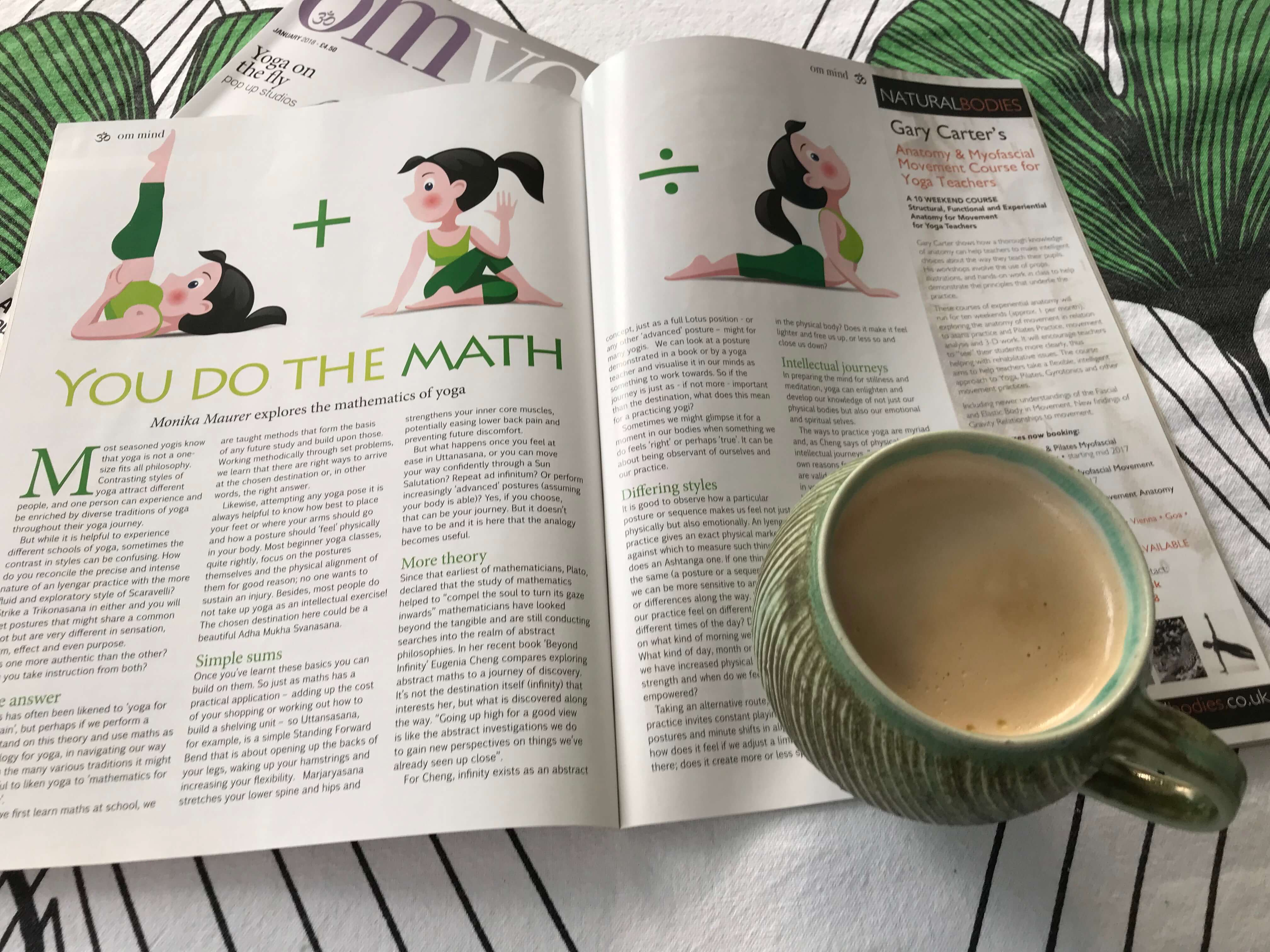 Cup of coffee with yoga magazine