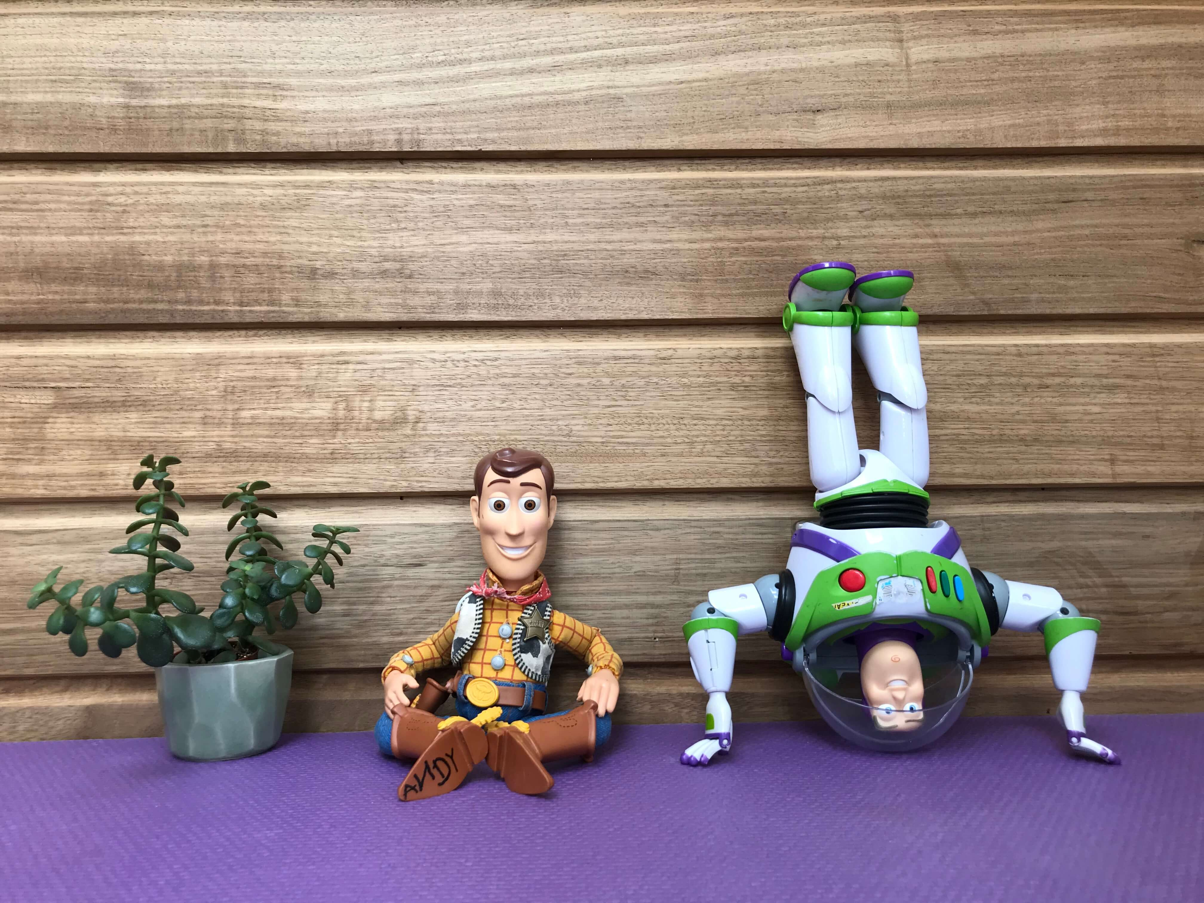 Buzz and Woody toys do yoga