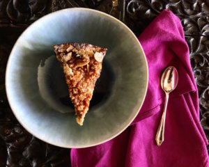 Rhubarb Crumble Cake on a table with a pink napkin