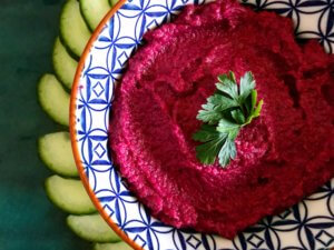 bowl of bright pink beetroot houmous