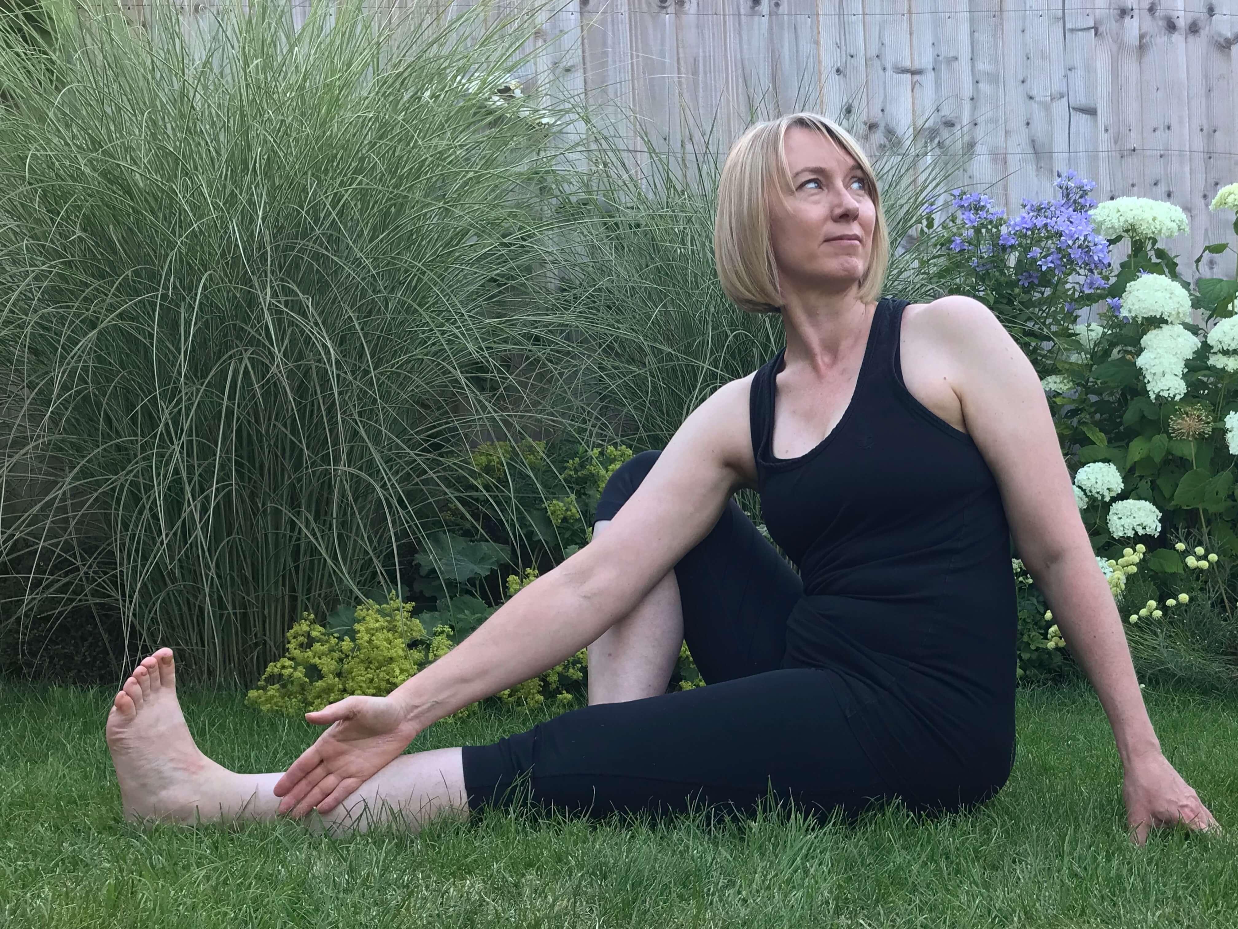 Woman practising twist in yoga