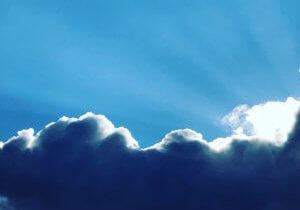 sun behind cloud