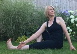Woman practising twist in yoga